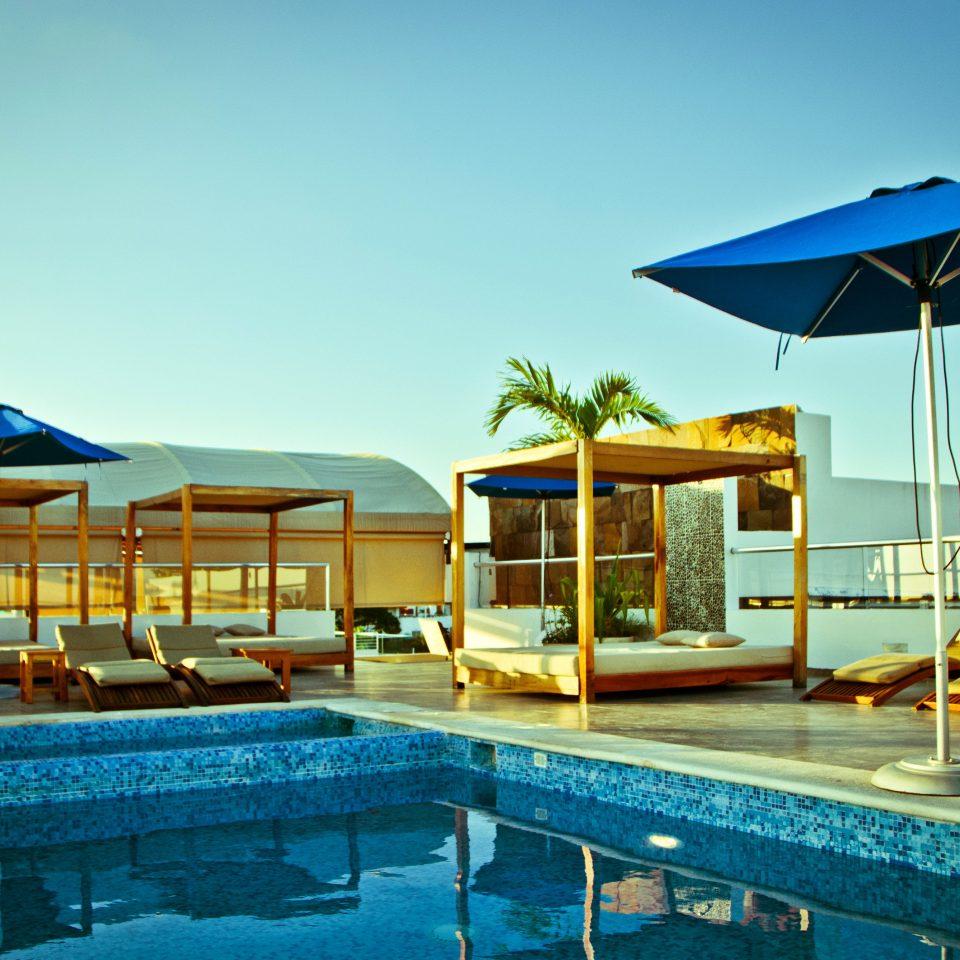 Luxury Patio Pool Rooftop sky umbrella chair leisure swimming pool Resort blue condominium swimming