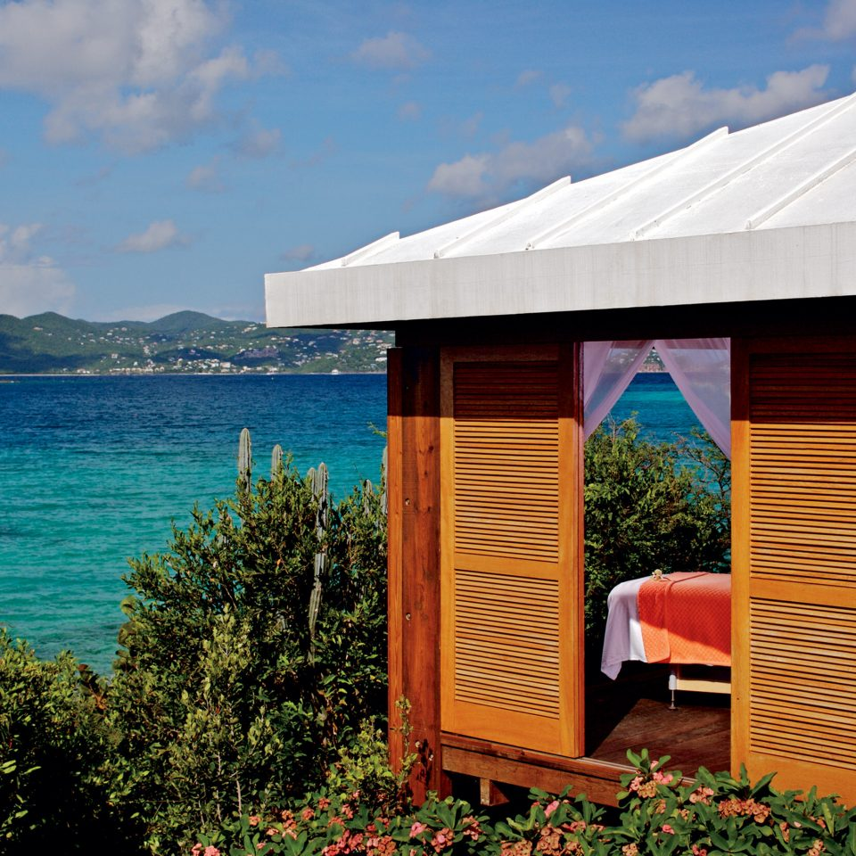 Luxury Scenic views Spa Tropical Waterfront Wellness sky water leisure hut cottage
