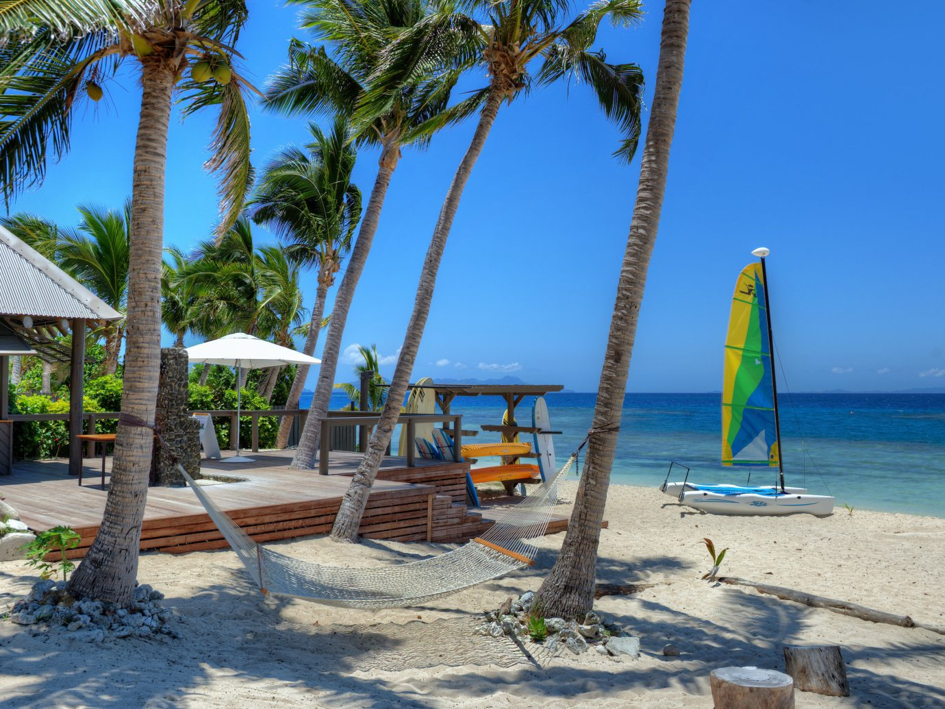 All-Inclusive Resorts Hotels Luxury Travel outdoor sky tree body of water Beach palm Resort palm tree tropics arecales Sea shore vacation coastal and oceanic landforms caribbean leisure plant tourism Ocean Coast bay real estate water Island sandy