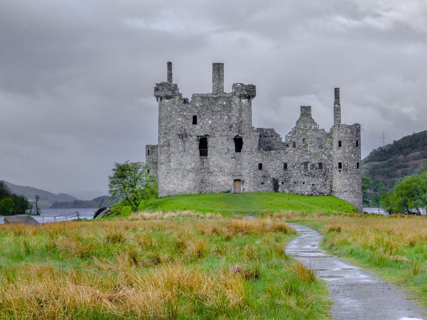 Landmarks Offbeat grass sky outdoor building castle green cloud highland Ruins fortification château tree medieval architecture grassy historic site history stone bastion