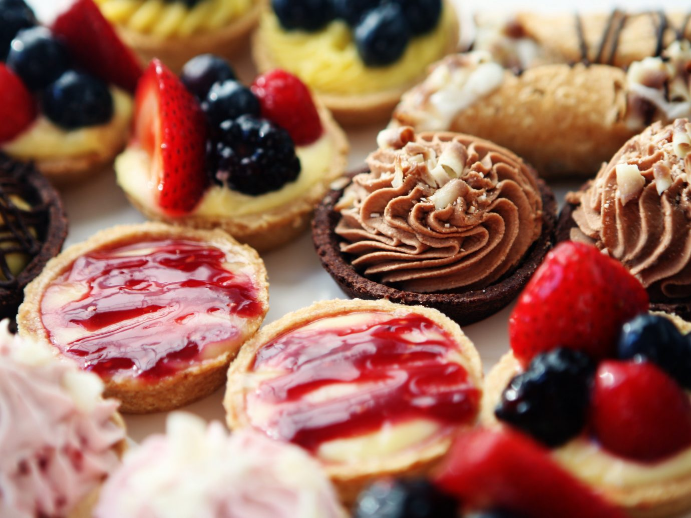 Food + Drink cake food dessert chocolate frutti di bosco piece pâtisserie decorated slice pastry produce fruit meal baked goods dish breakfast sweetness baking petit four danish pastry flavor close sliced baked