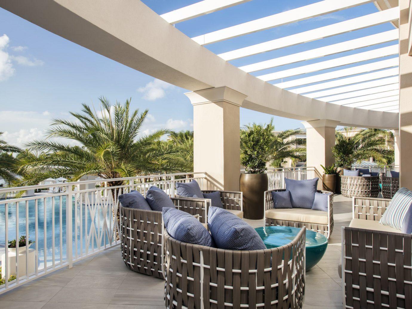 Beach chair property home estate condominium porch real estate outdoor structure interior design swimming pool backyard Villa furniture Deck