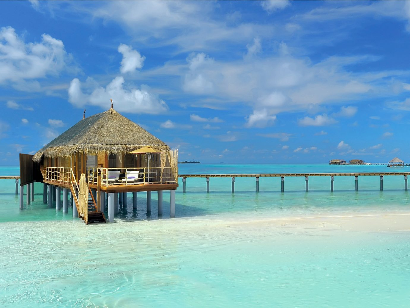 All-Inclusive Resorts Hotels Island Luxury Luxury Travel Overwater Bungalow Romance Romantic Waterfront sky water pier scene outdoor Sea Beach Ocean vacation caribbean Resort shore Coast estate bay swimming pool Lagoon Pool tropics blue swimming day