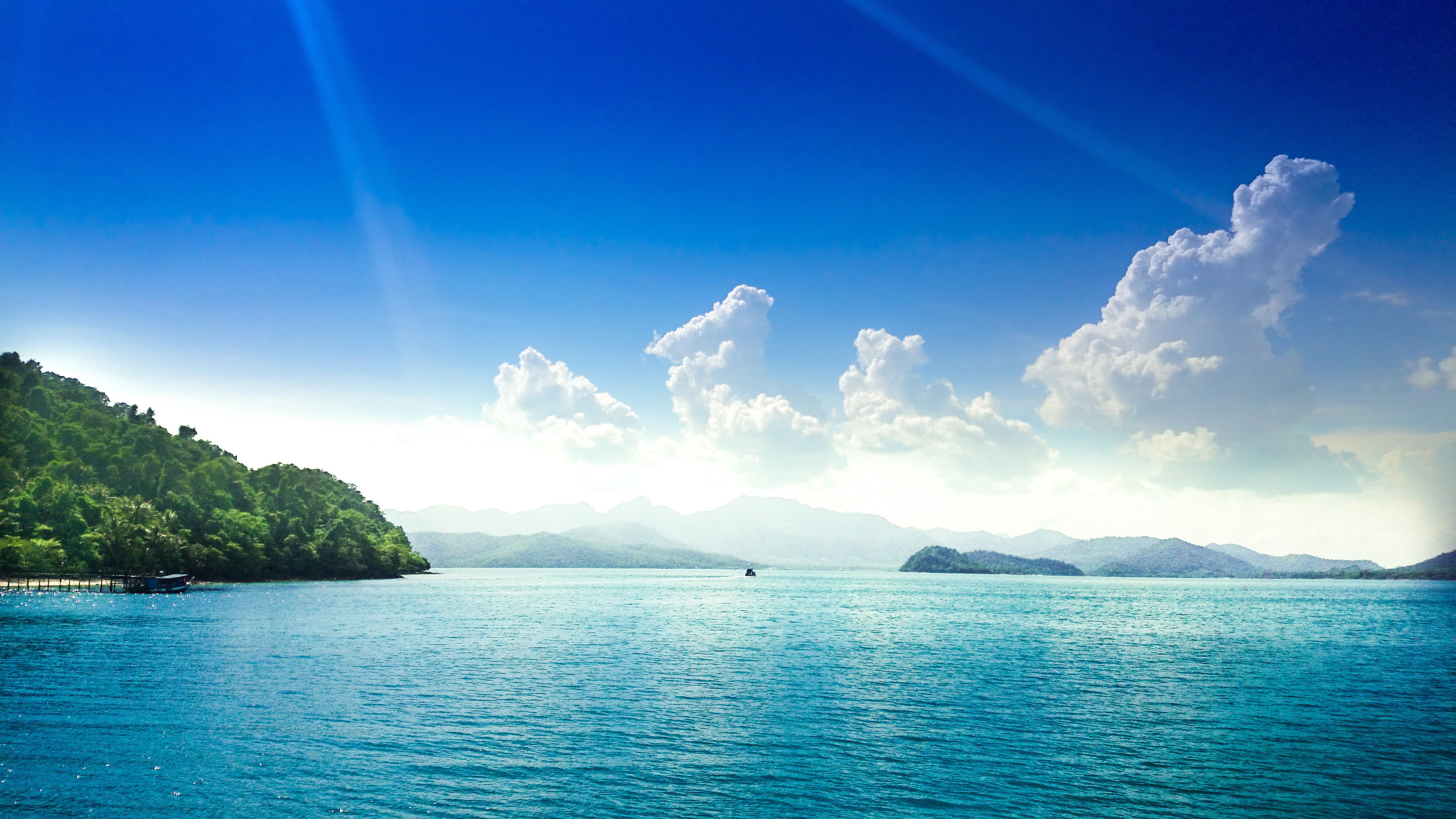 Jetsetter Guides water sky outdoor Boat Lake Nature mountain horizon cloud Sea body of water Ocean reflection fjord background sunlight bay loch blue computer wallpaper Island dusk Lagoon clouds day shore distance surrounded