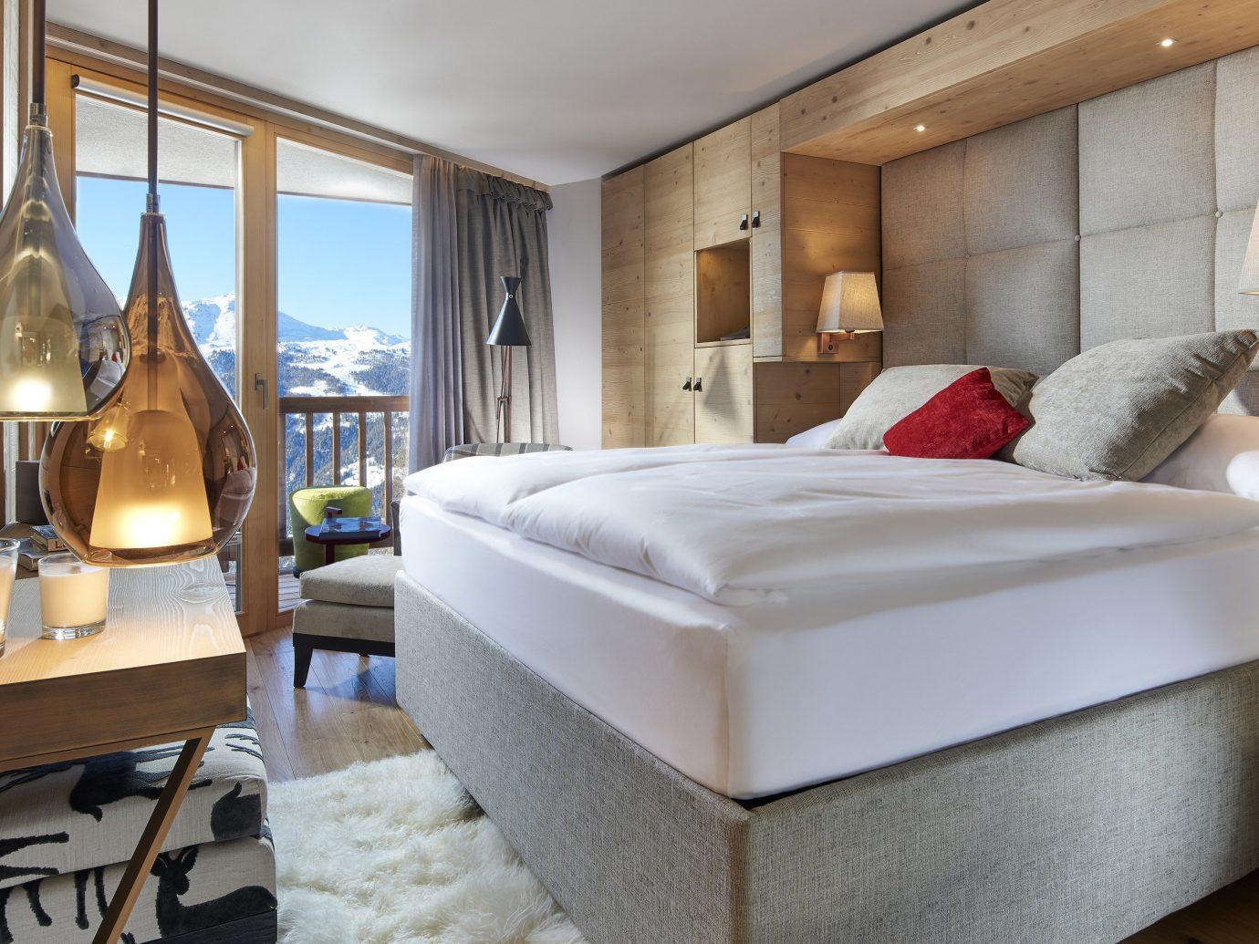 Boutique Hotels Hotels Outdoors + Adventure Winter indoor floor bed room Suite interior design Bedroom bed frame ceiling hotel interior designer