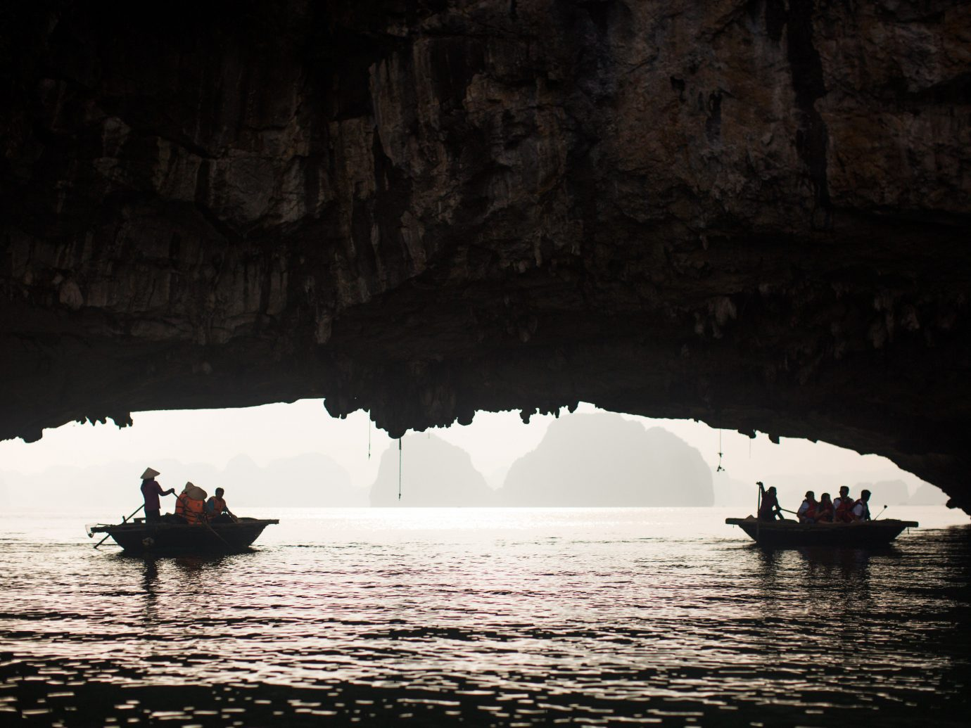 water outdoor Nature cave Boat geographical feature landform sea cave darkness reflection Sea formation bay distance