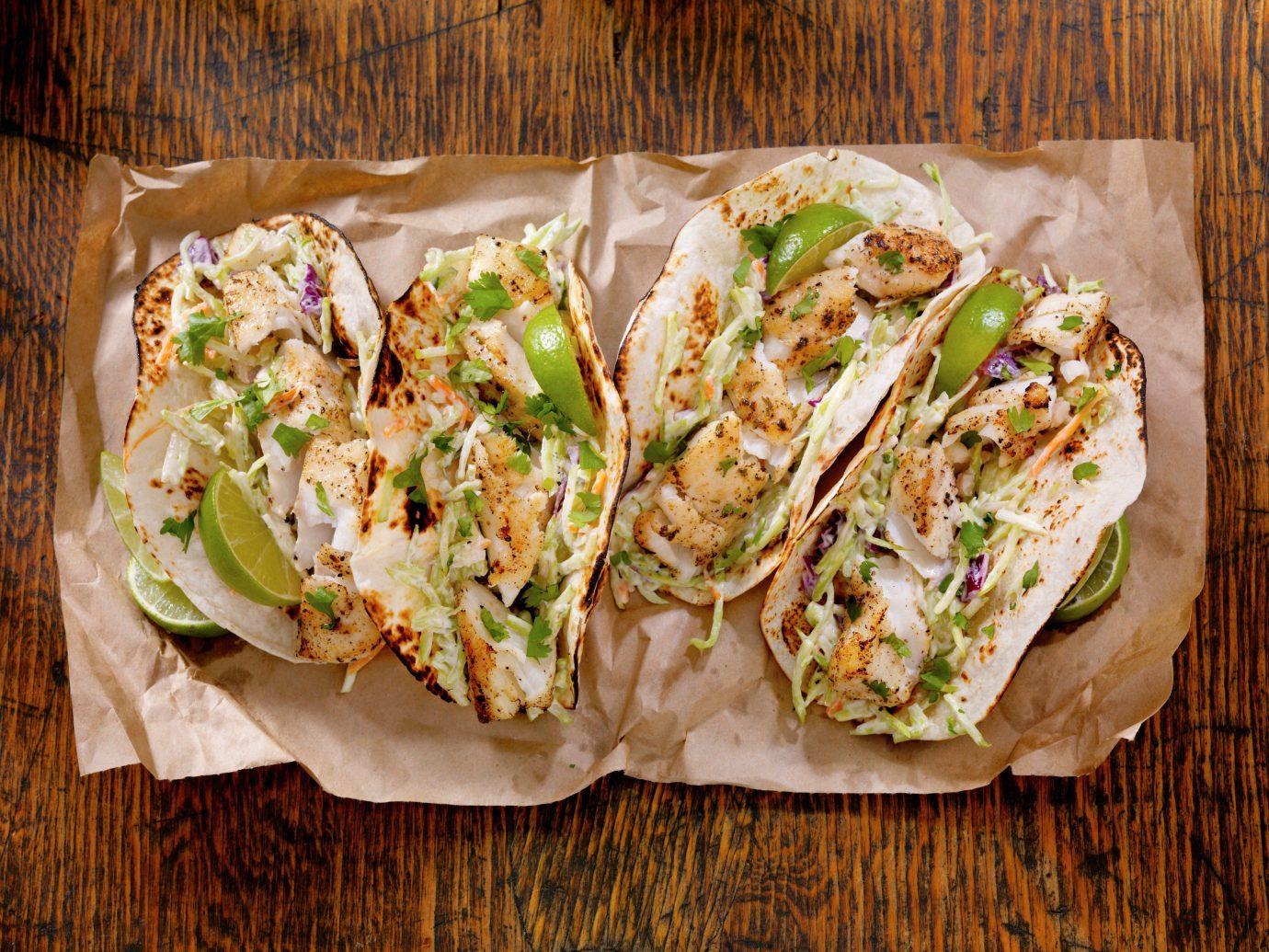 Food + Drink food dish wooden produce vegetable land plant cuisine taco meal salad snack food flowering plant breakfast sandwich bread
