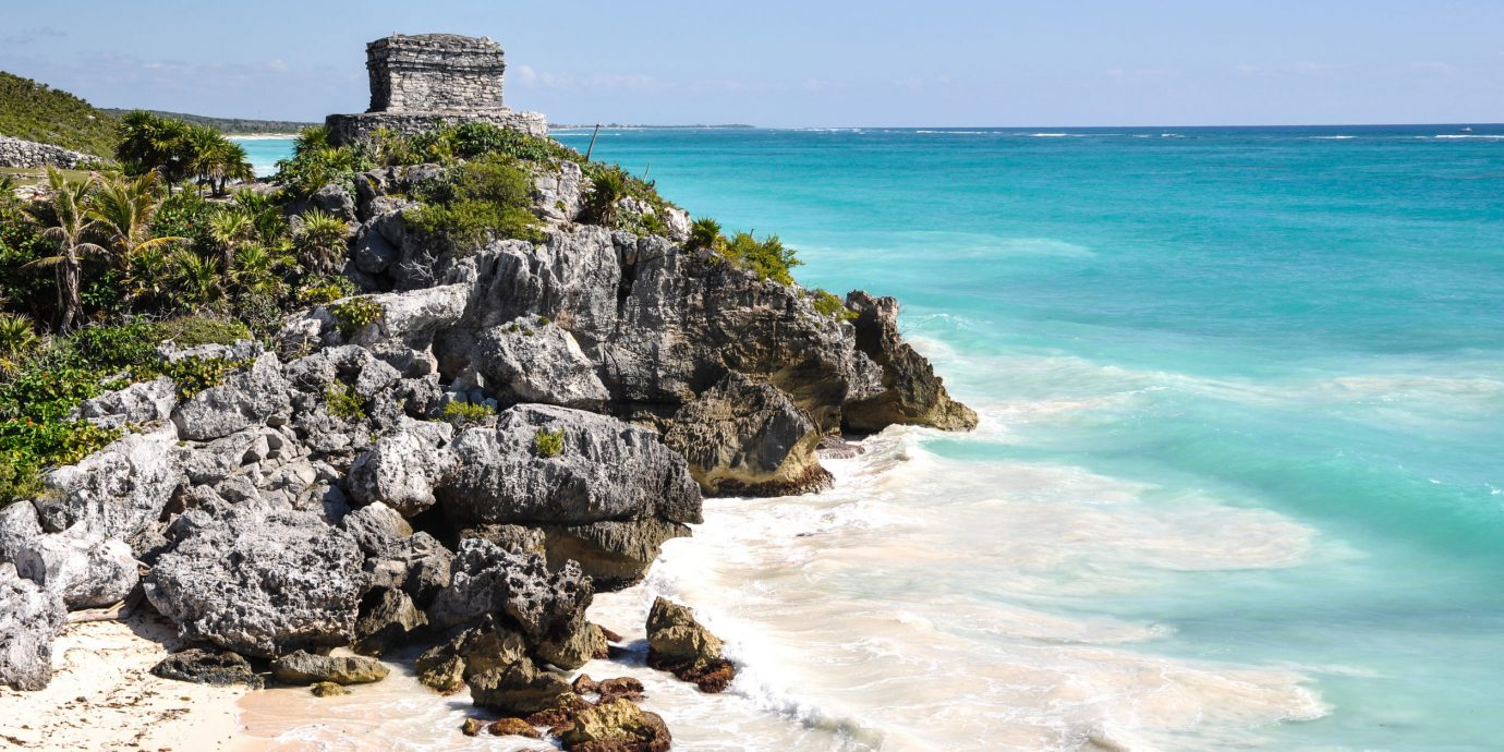 City Mexico Trip Ideas Tulum water outdoor sky rock Nature shore Coast Sea body of water Ocean rocky Beach vacation cove bay islet wind wave cape cliff terrain wave material