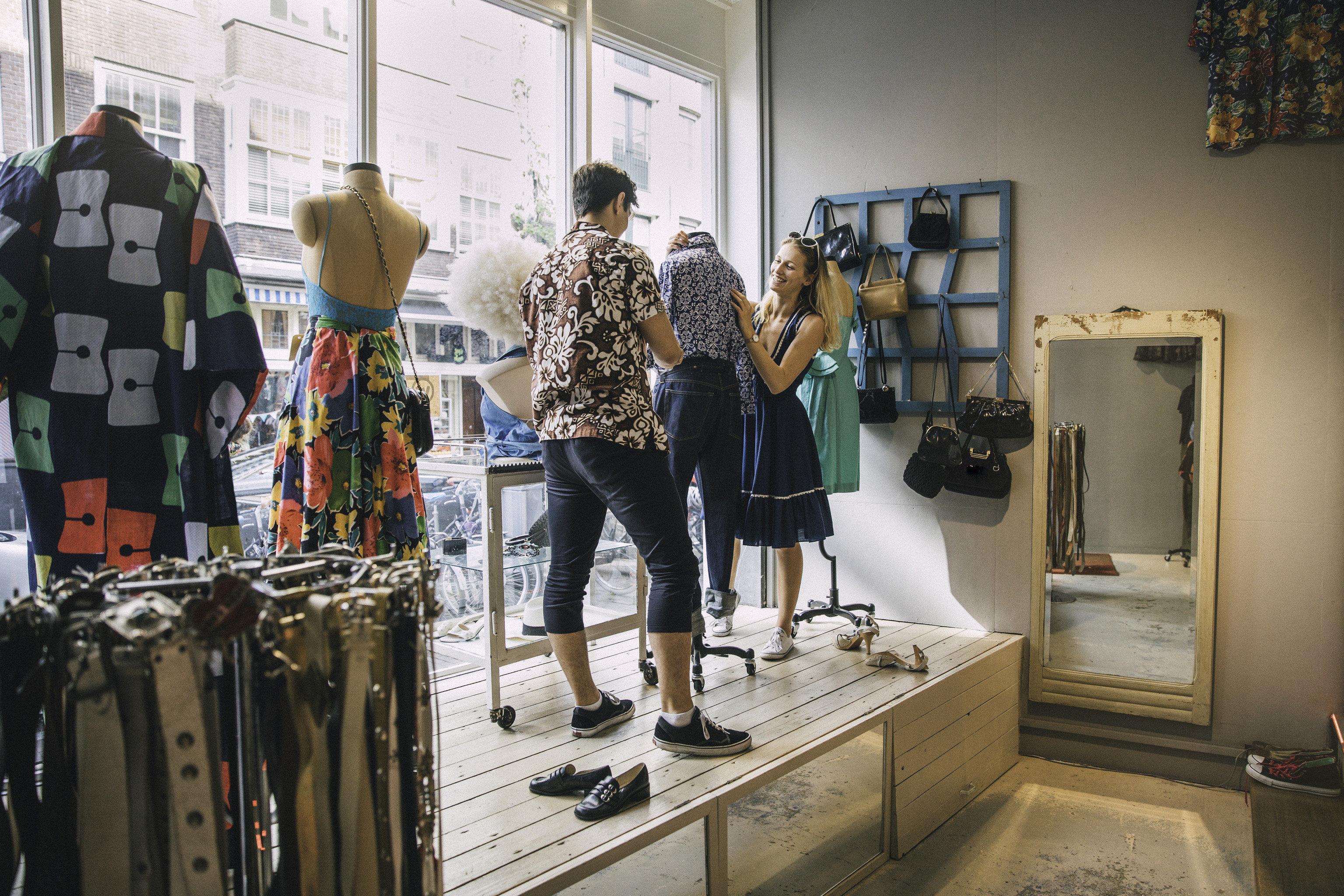 Travel Shop indoor person display window Boutique fashion Design retail interior design buyer shopping window