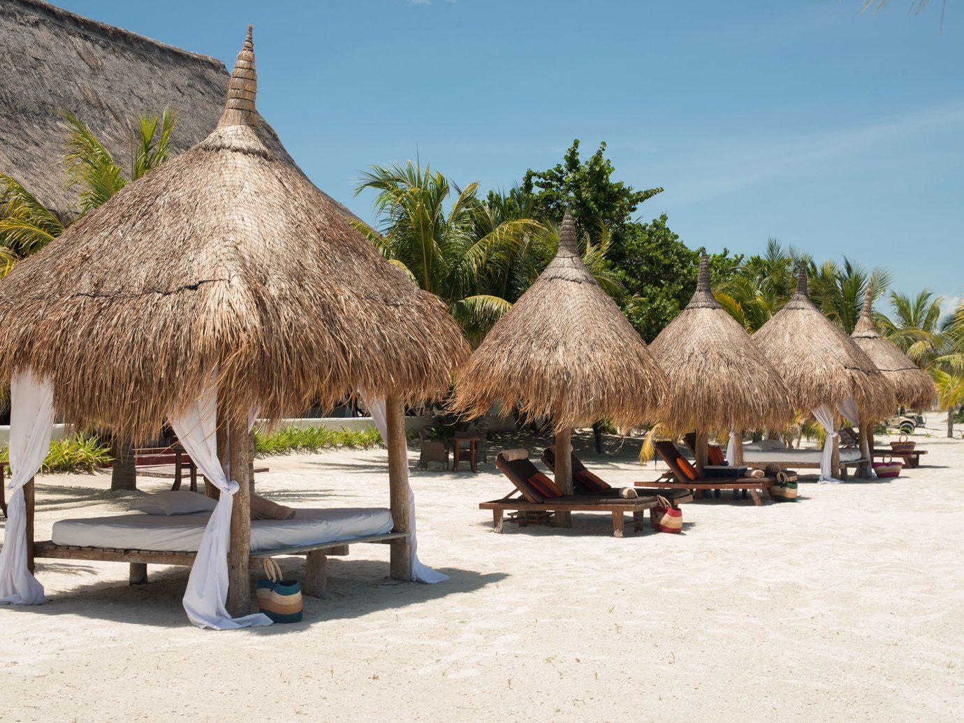 Beach Beachfront Secret Getaways Trip Ideas outdoor sky tree vacation Resort tourism arecales hut restaurant Village travel day
