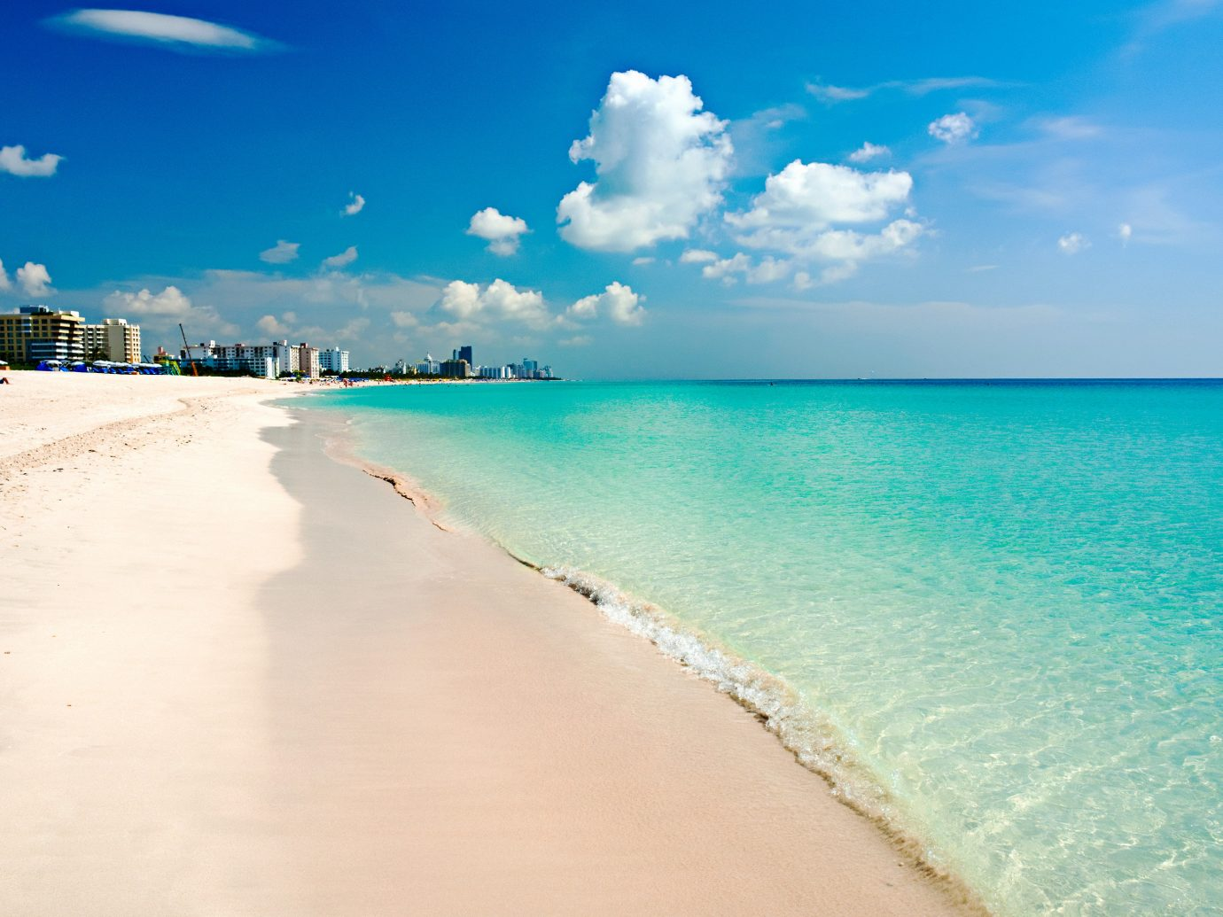 Beach Beachfront Hotels Ocean Outdoors Waterfront sky water outdoor ground Nature Sea shore body of water horizon sand vacation caribbean wave Coast wind wave cloud sunlight sandy bay day