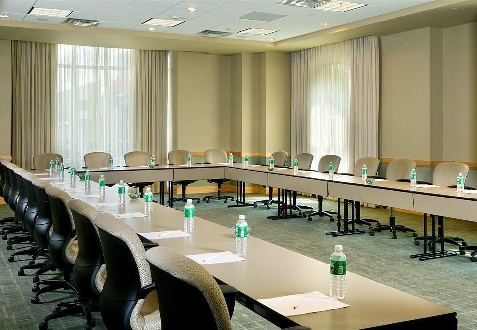 conference hall classroom desk auditorium function hall meeting convention center seminar Modern conference room