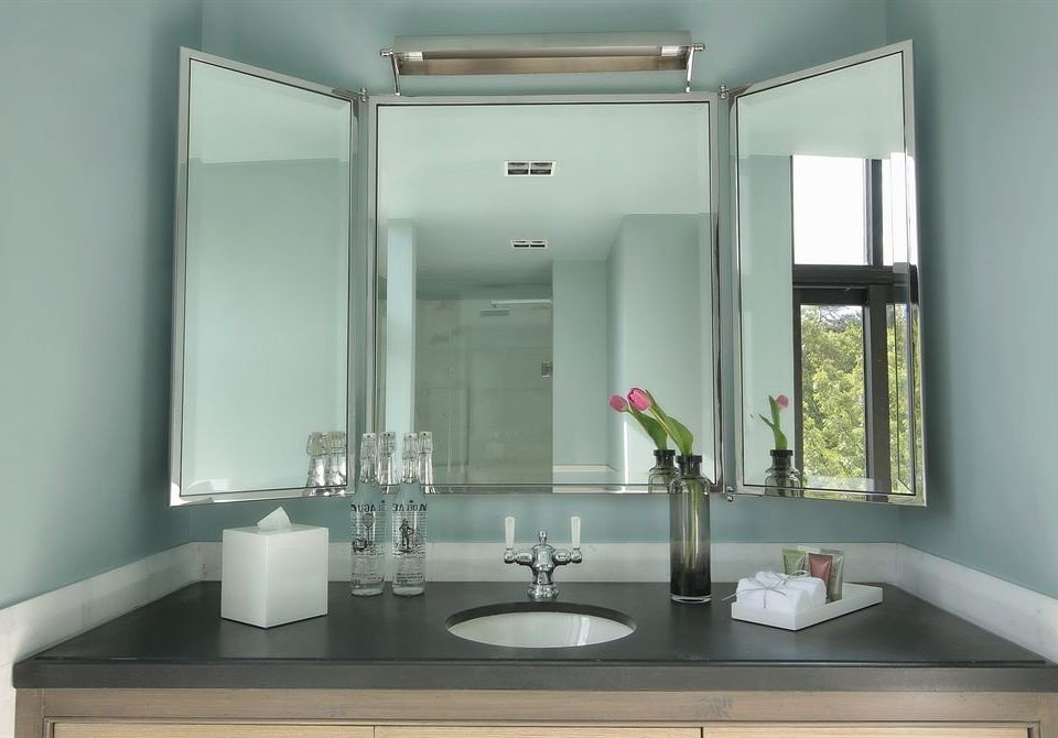 bathroom mirror sink plumbing fixture lighting home bathroom cabinet flooring Modern