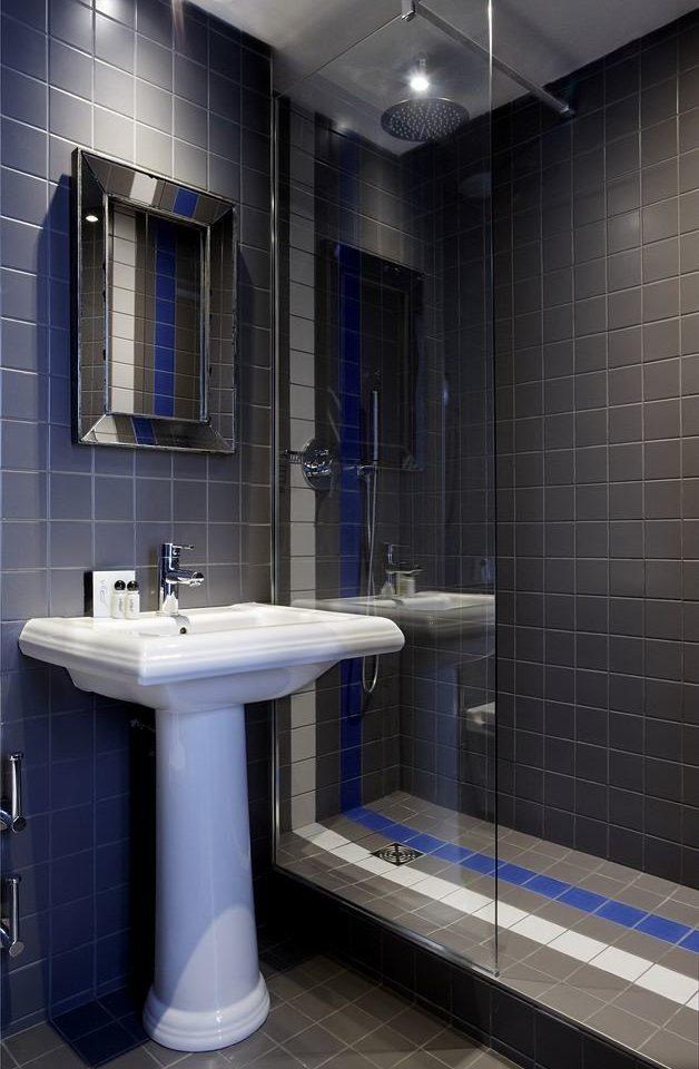 bathroom sink tiled toilet tile plumbing fixture public toilet flooring public bidet swimming pool bathtub restroom tub Modern long