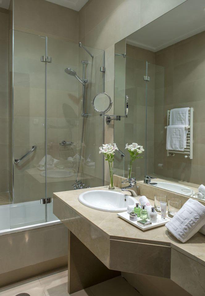 bathroom sink mirror property plumbing fixture bathtub flooring bidet toilet Modern