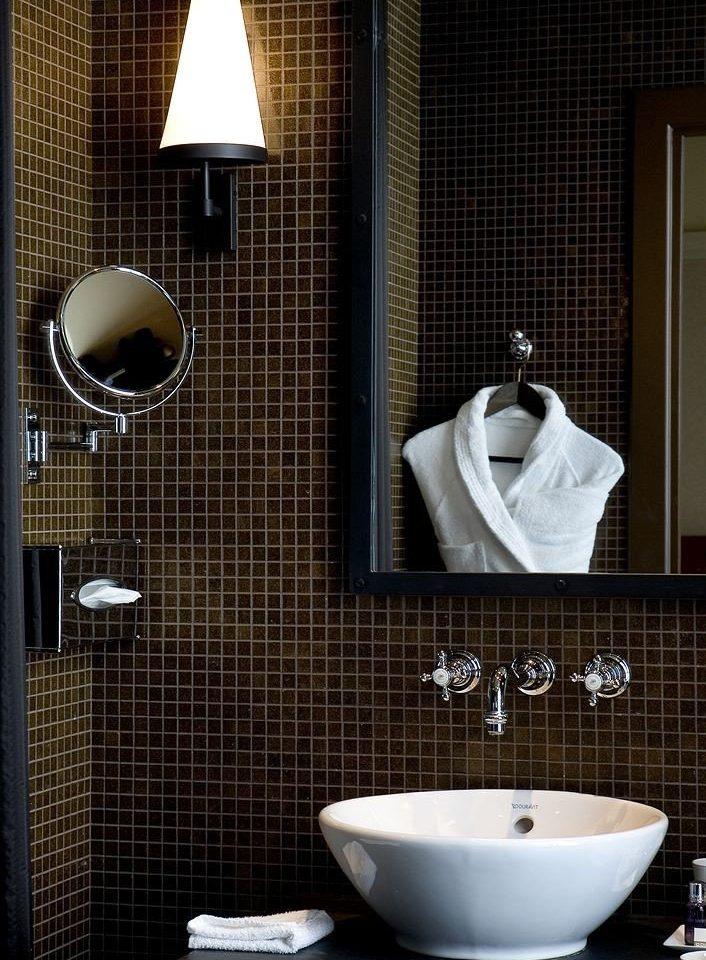 bathroom sink mirror plumbing fixture towel bathtub bidet tile toilet Modern tiled public
