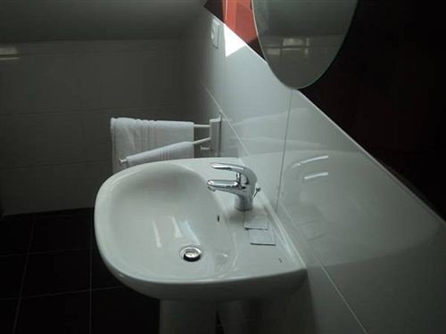 bathroom toilet plumbing fixture bidet sink white bathtub tap tile tiled Modern