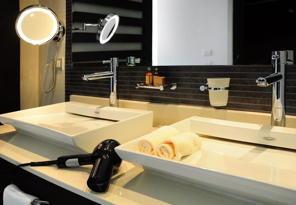 bathroom sink counter lighting living room plumbing fixture countertop shelf bathtub Modern