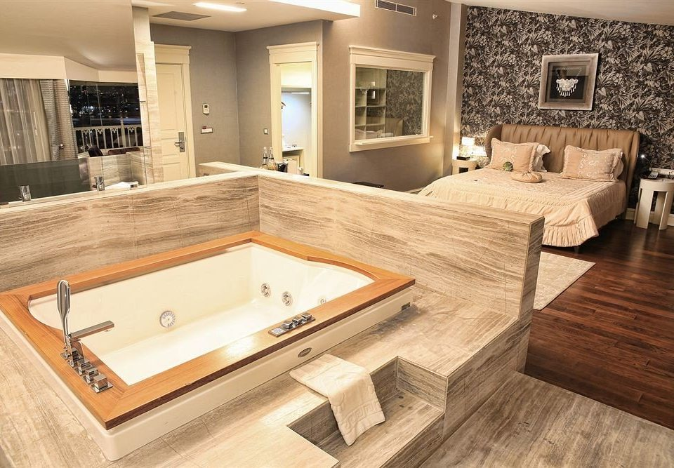 bathroom property countertop sink hardwood home flooring swimming pool wood flooring plumbing fixture bathtub Modern