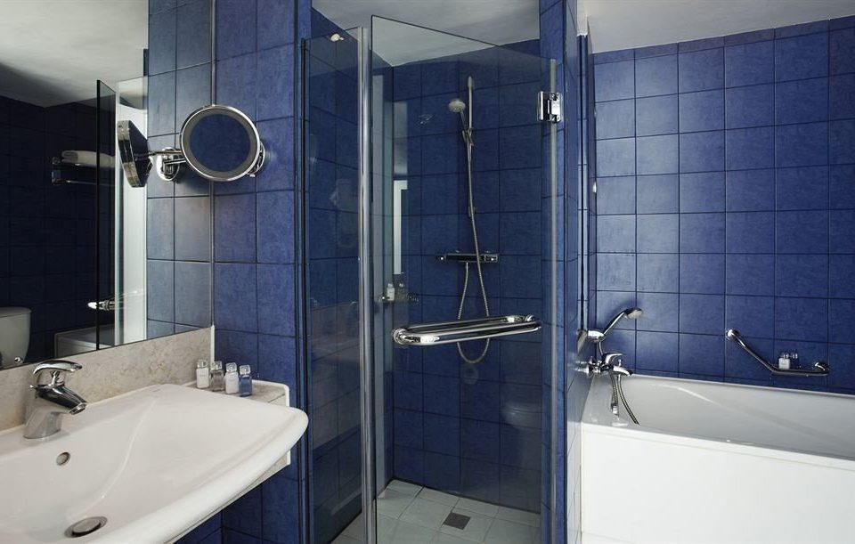 bathroom sink property toilet tile plumbing fixture tiled public toilet Modern tub bathtub
