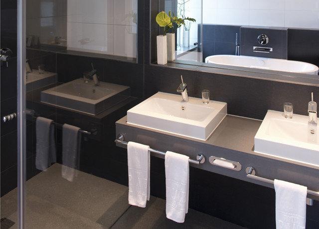 bathroom mirror sink property plumbing fixture countertop bidet flooring toilet Modern