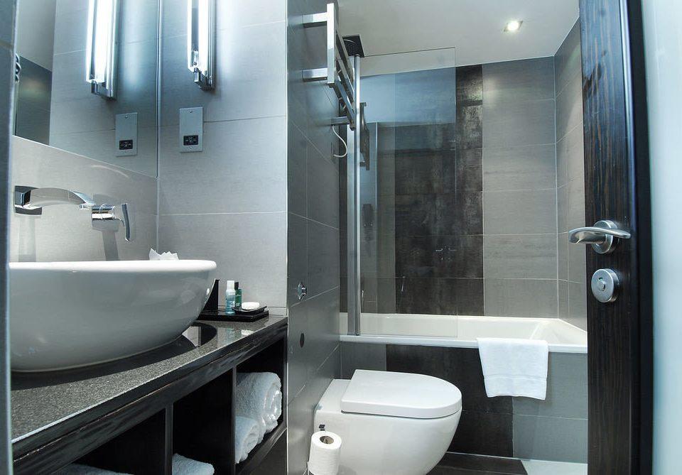 bathroom sink toilet mirror property plumbing fixture bidet public toilet vessel Modern