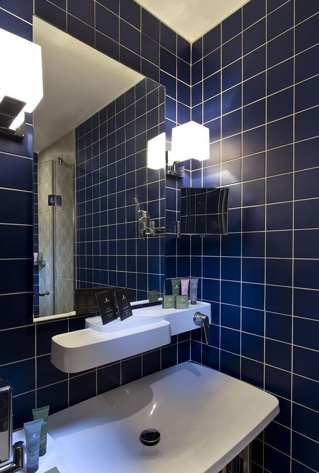 bathroom black lighting tiled daylighting flooring plumbing fixture toilet sink tile Modern water basin square