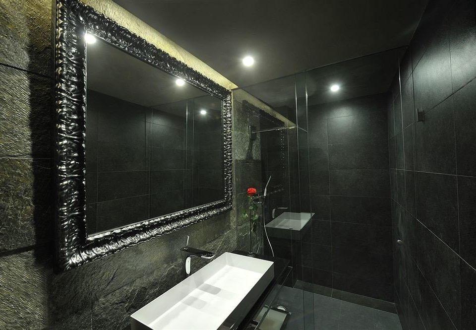 bathroom black plumbing fixture public toilet tile tiled public Modern
