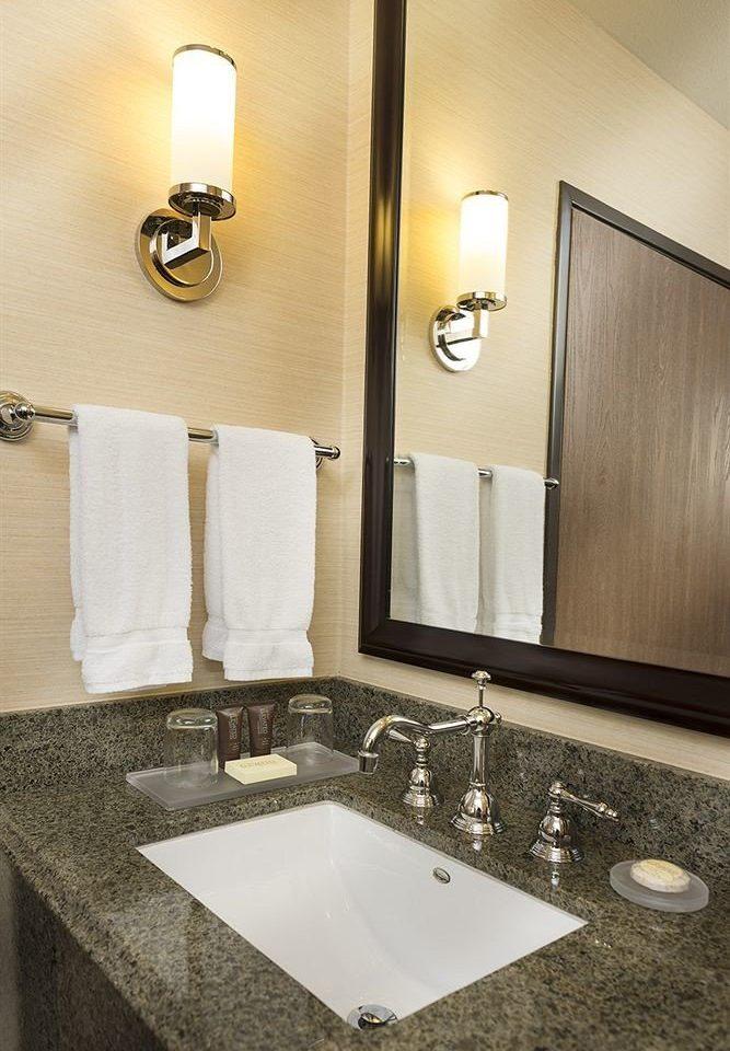 bathroom sink mirror towel countertop counter vanity double toilet plumbing fixture lighting flooring material tile clean Modern rack