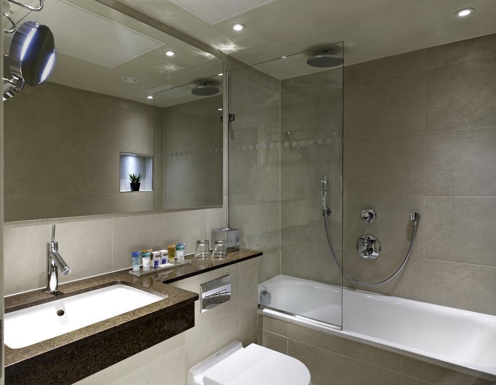 bathroom sink mirror property toilet home counter plumbing fixture clean Modern tub tile