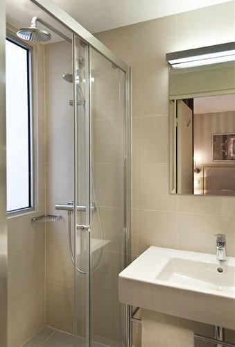 bathroom sink mirror shower glass scene plumbing fixture Modern clean tan