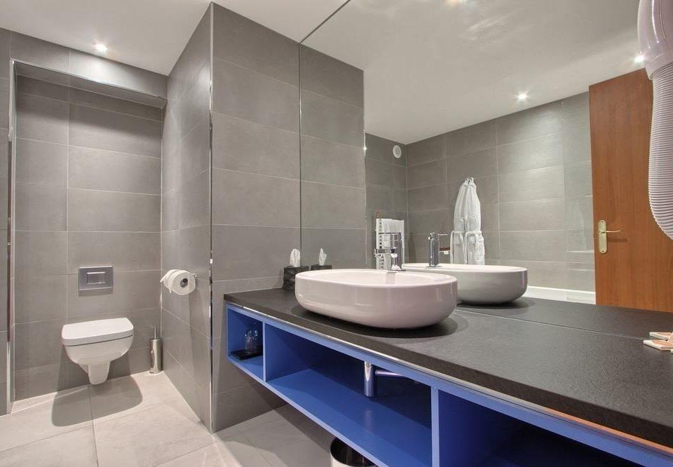 bathroom sink property toilet flooring counter Modern