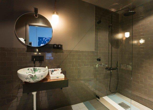 bathroom mirror sink property toilet lighting home tiled swimming pool tile plumbing fixture public Modern