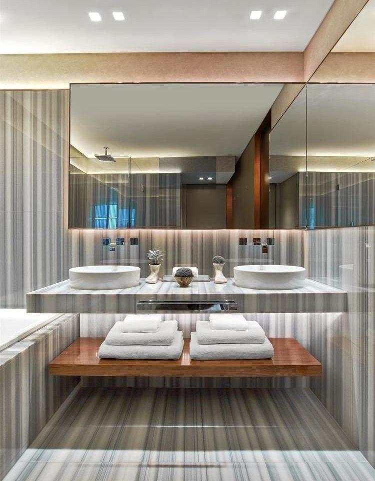 property hardwood home condominium living room cabinetry daylighting sink wood flooring flooring tub counter Modern bathtub tile