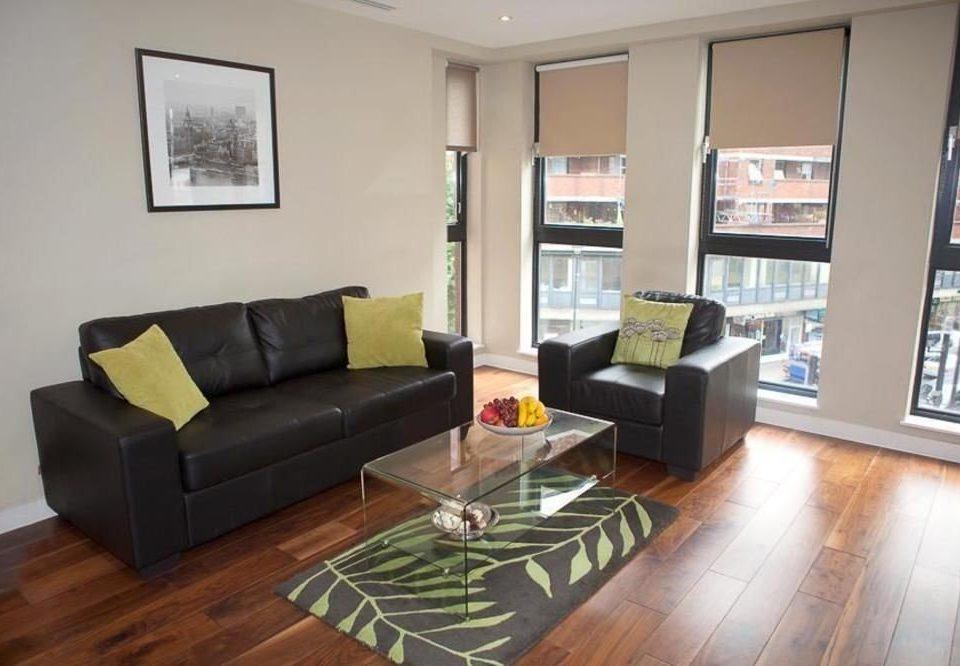 sofa living room property condominium home hardwood wood flooring loft cottage flooring laminate flooring leather hard flat Modern