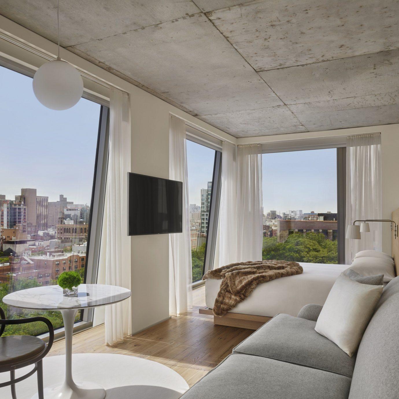 sofa property living room penthouse apartment house interior designer daylighting nice condominium Modern
