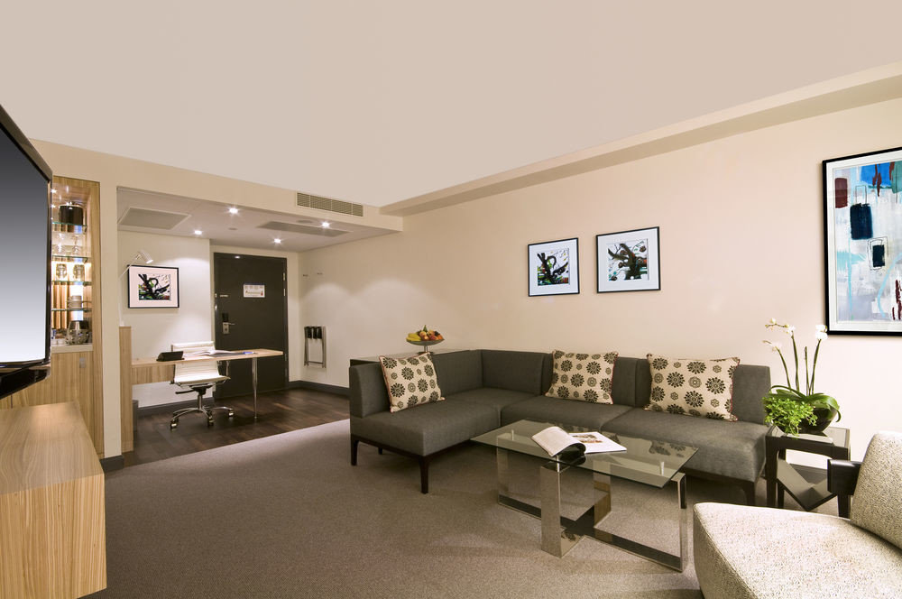 sofa property living room condominium home waiting room loft flat Modern