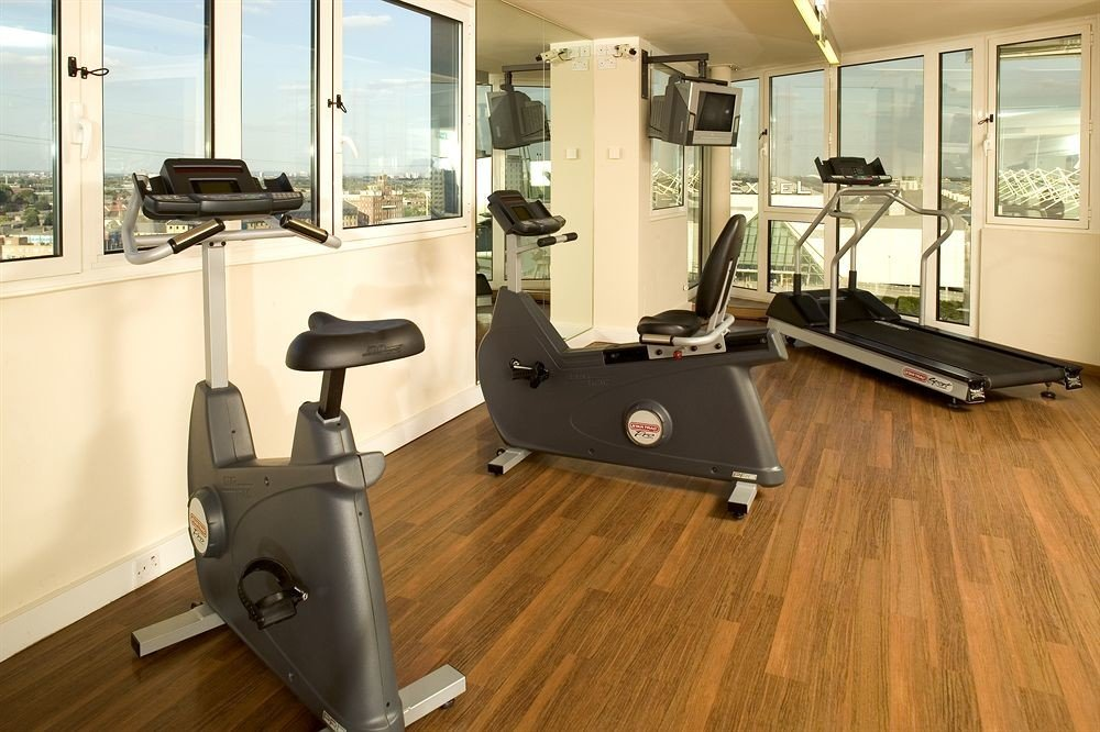 structure property sport venue condominium living room laminate flooring hard flooring Modern