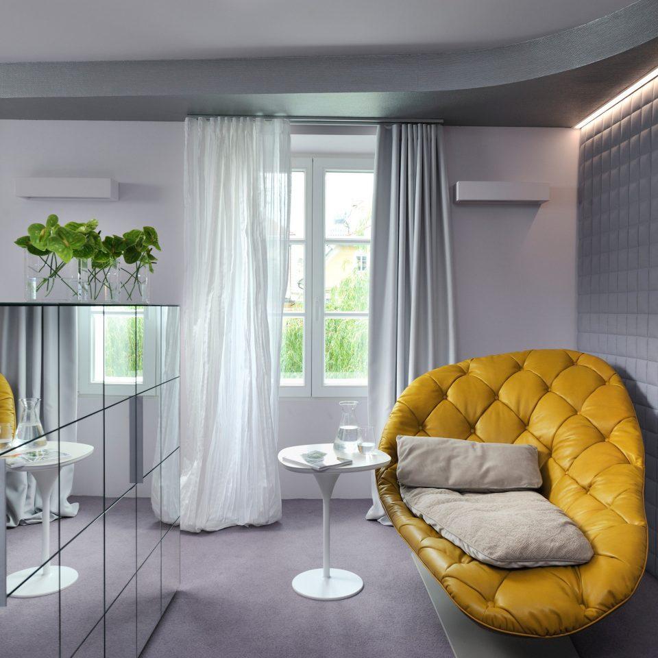 Modern Resort property yellow home condominium Suite living room