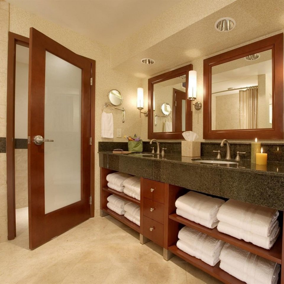 bathroom mirror property sink cabinetry hardwood home Suite basement Modern