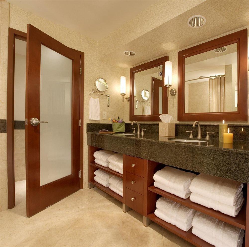 bathroom mirror property sink cabinetry hardwood home Suite basement Modern