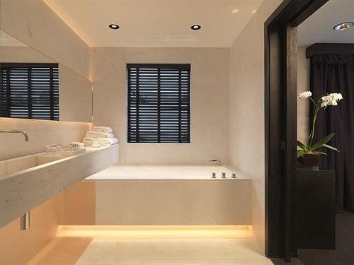 property bathroom sink home Suite plumbing fixture bathtub flooring Modern clean tub