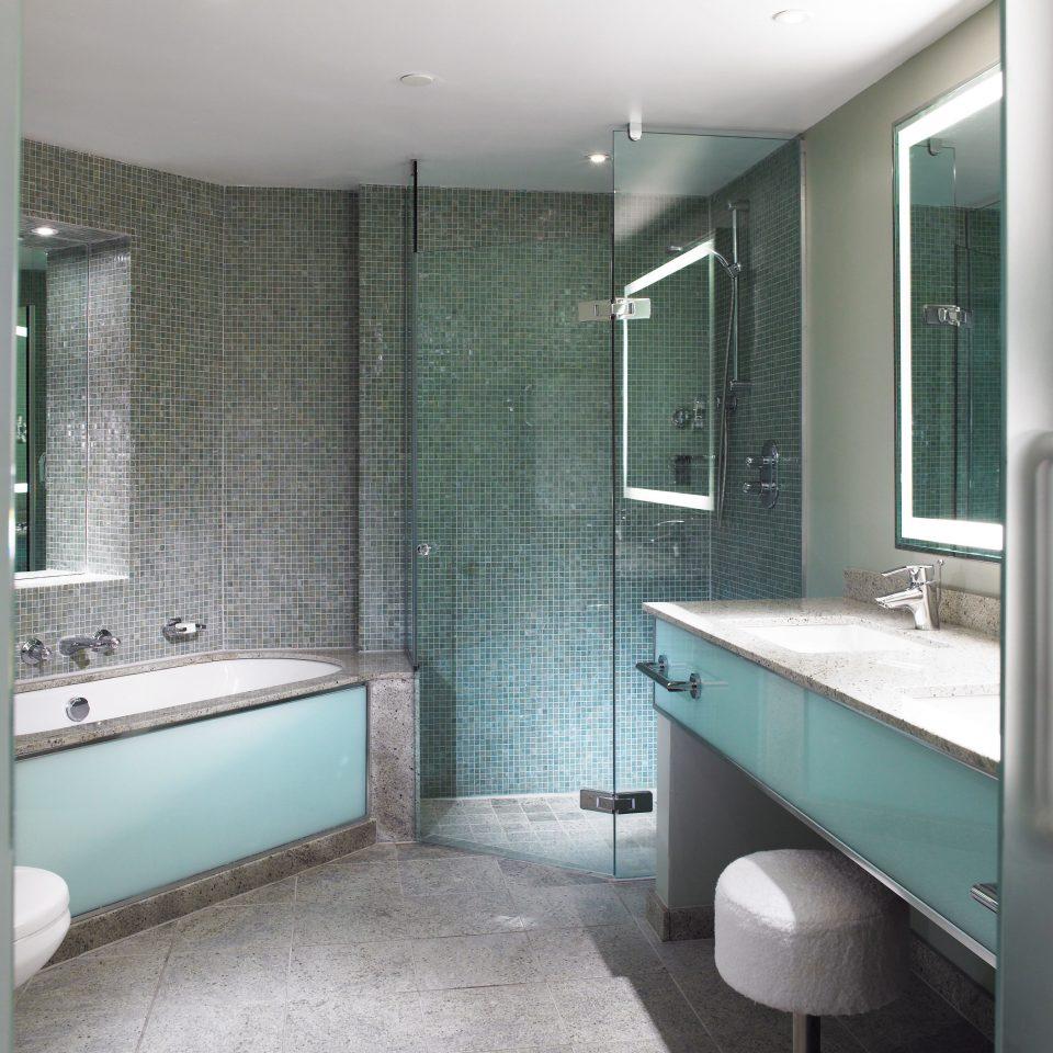 bathroom property sink green plumbing fixture bathtub Suite Modern tiled tile