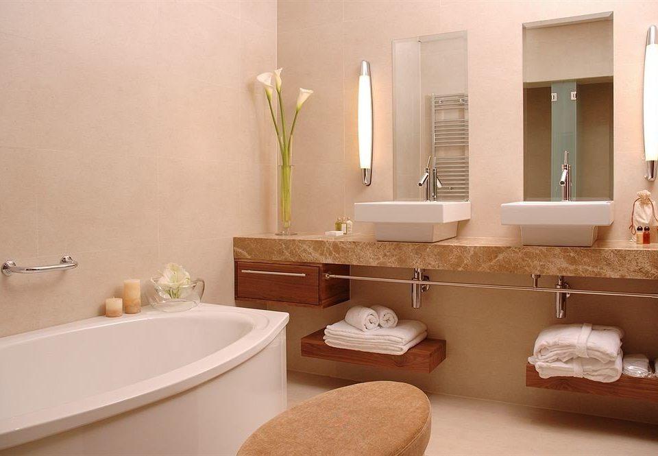 bathroom property home plumbing fixture Suite bathtub flooring Modern