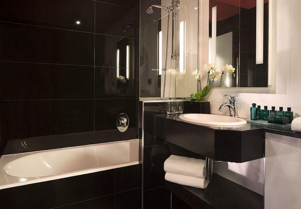 bathroom sink mirror property toilet white home light countertop plumbing fixture bathtub Suite flooring Modern tile tub