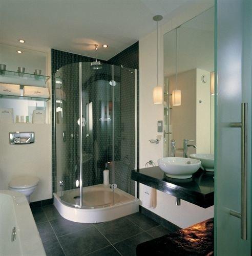bathroom sink mirror property plumbing fixture Suite bathtub toilet Modern