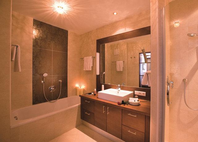 bathroom property light sink home lit cabinetry plumbing fixture Suite Modern