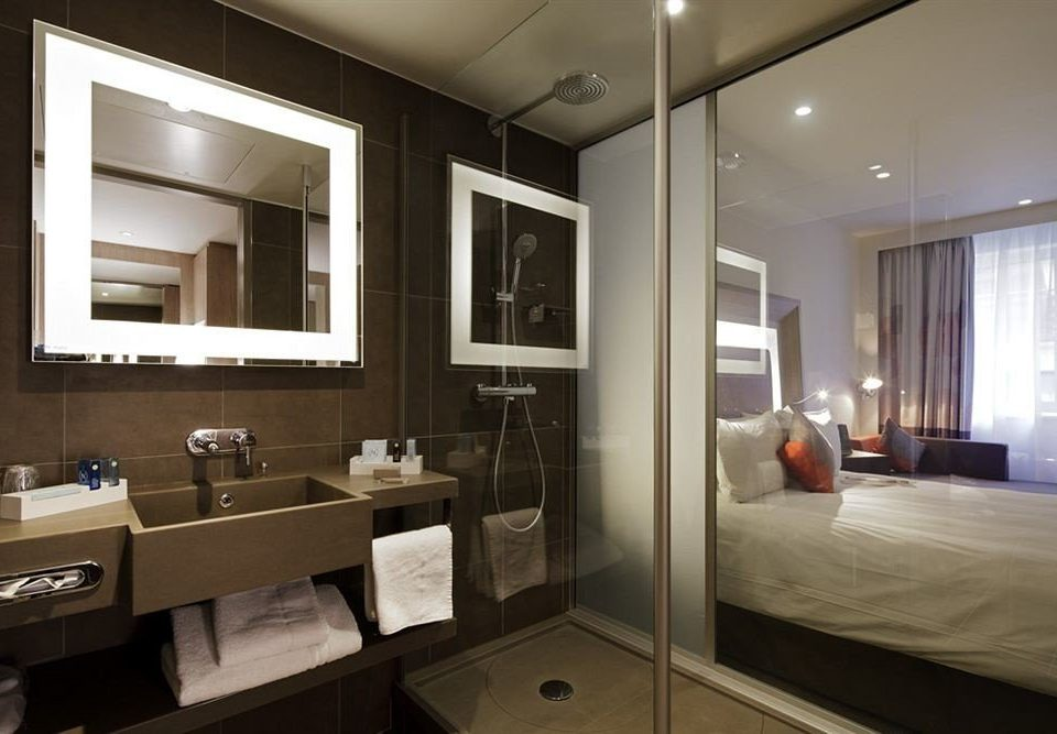 bathroom mirror property sink home lighting condominium Suite cabinetry living room Modern