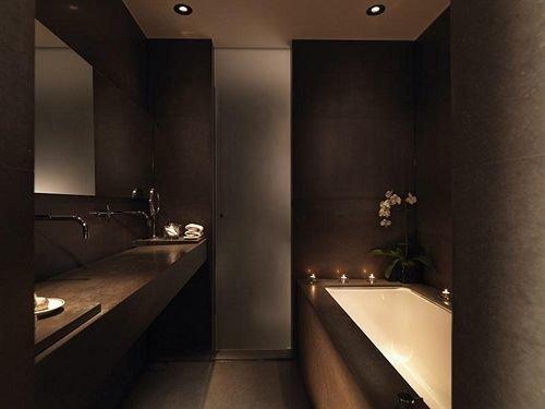 bathroom sink mirror property house light lighting toilet Suite lit plumbing fixture Modern clean