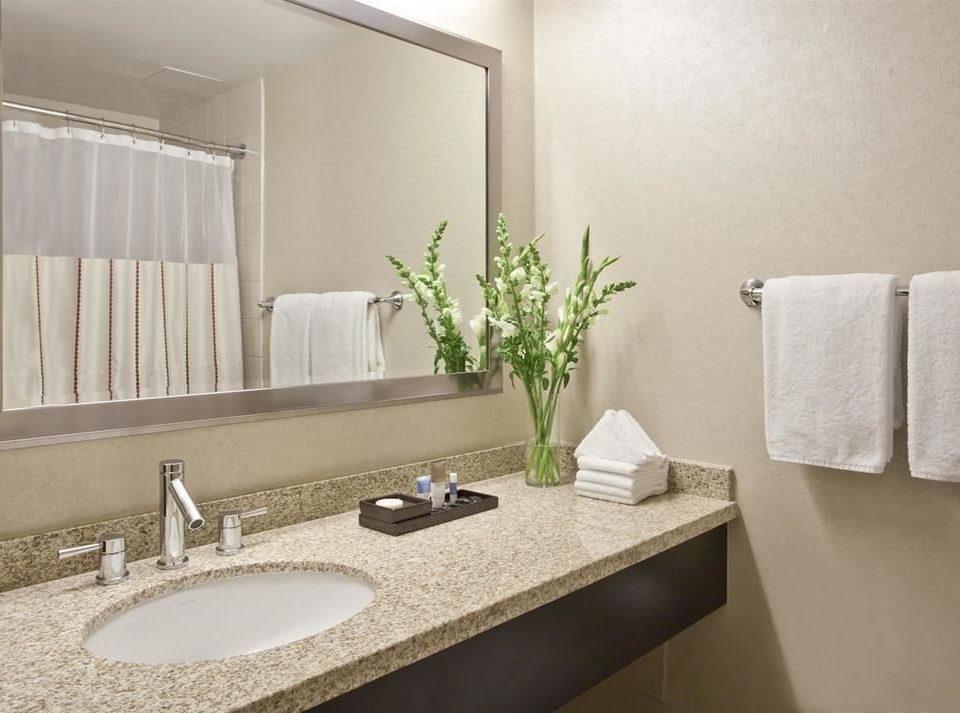 bathroom mirror sink property towel Suite counter vanity home flooring clean Modern